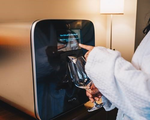 Guest using Plum Wine Dispenser
